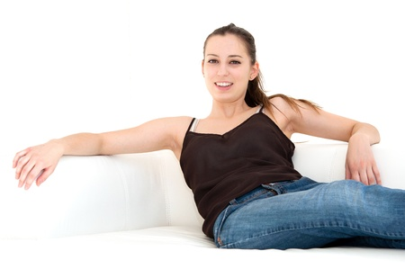 beautiful young woman on the couch in the living room photo