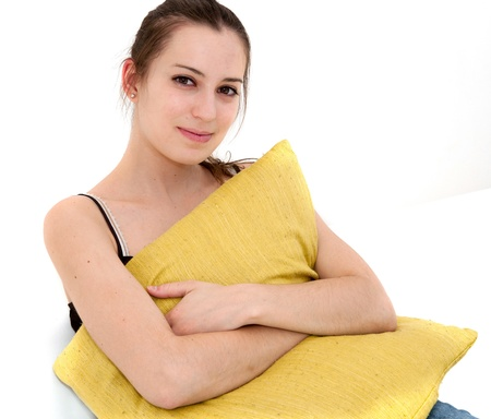 beautiful smile young woman with green pillow photo