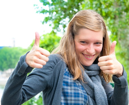 smiling beautiful happy woman with thumbs up Stock Photo - 12626190
