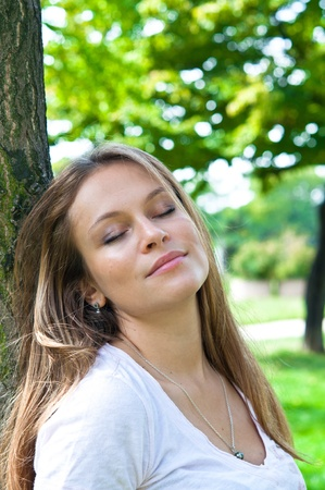 beautiful young attractive girl breathing in wild nature Stock Photo