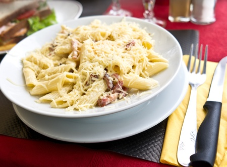 jambon: tasty pasta with roast ham on the table