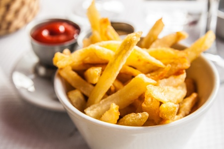 french fries: Golden French fries potatoes ready to be eaten Stock Photo