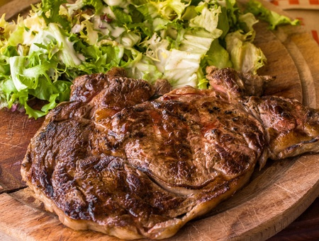Grilled steak - Grilled meat ribs on the plate with hot sauce Stock Photo - 12845508