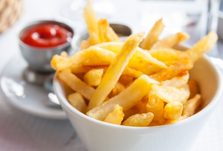 fries: Golden French fries potatoes ready to be eaten Stock Photo