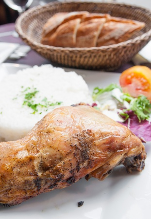 fried chicken with rice and fresh salad photo