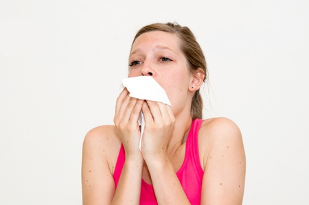 woman using tissue on white background photo