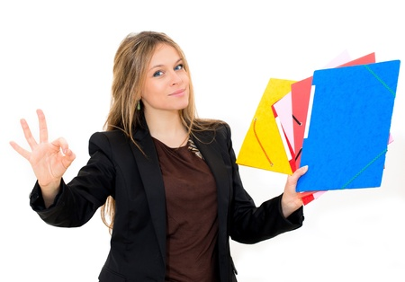 smiling woman with OK gesture and folder on white background photo