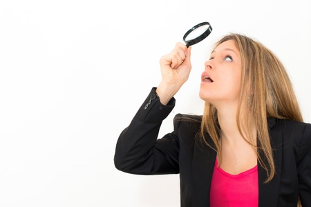 woman with magnifying glass on a white background photo