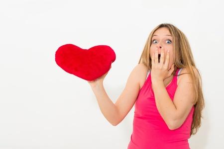 young lonely sad woman holding red valentine heart photo