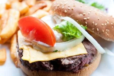 Cheese burger - American cheese burger with fresh salad Stock Photo - 13428411