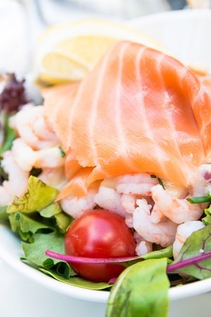 Fresh seafood salad with smoked salmon photo