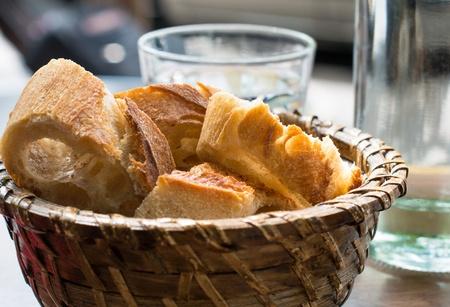 bread in basket - little roll breads in basket on table photo