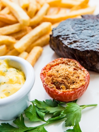 juicy steak beef meat with tomato and french fries Stock Photo - 13711214