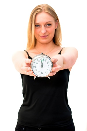 young beautiful woman holding a clock on a white background photo
