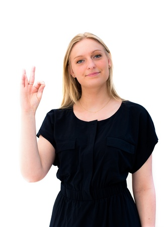 Young woman showing OK hand sign smiling happy on white background. photo