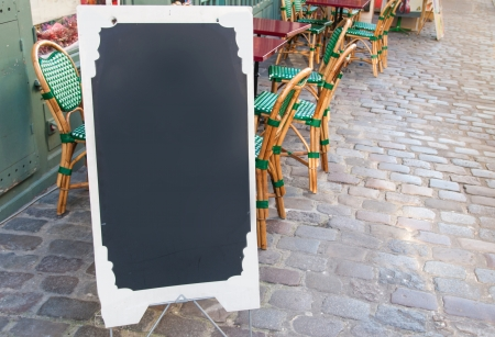 Paris street view of a Restaurants terrace with blackboard photo