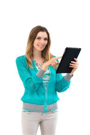 young woman holding in hand a tablet touch pad, on a white background Stock Photo - 14402530