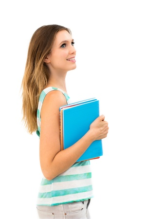 Young smiling woman holding notebooks isolated over a whte background photo