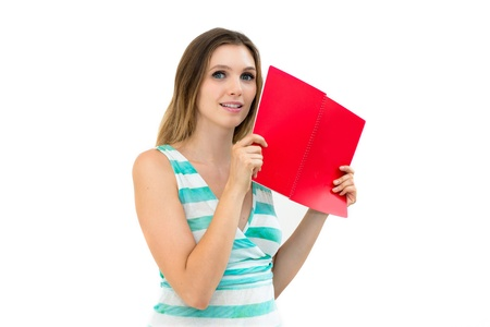 Young smiling woman reading book isolated over white photo