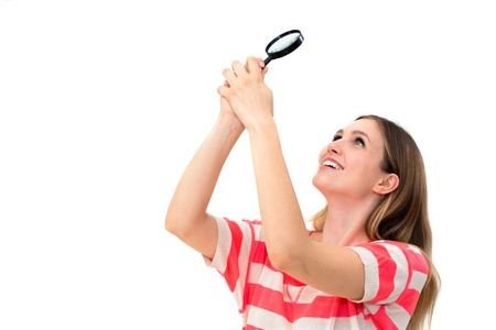 woman with magnifying glass on a white background Stock Photo - 14402487