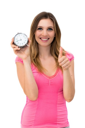 young beautiful woman holding a clock on a white background Stock Photo - 14429974