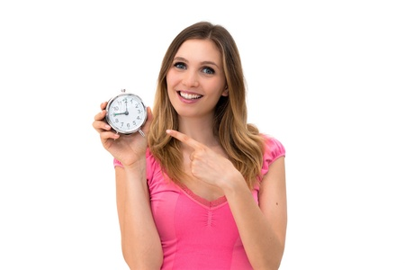 young beautiful woman holding a clock on a white background Stock Photo - 14402502