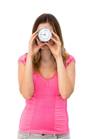 young beautiful woman holding a clock on a white background Stock Photo - 14429366
