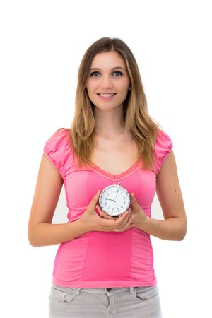 young beautiful woman holding a clock on a white background Stock Photo - 14402638