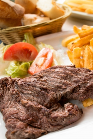 juicy steak beef meat with tomato and french fries Stock Photo - 14503517