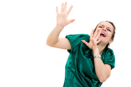 Young woman screaming. against a white background. photo