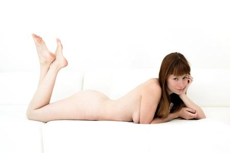 Beautiful naked woman on a sofa Stock Photo - 14596624