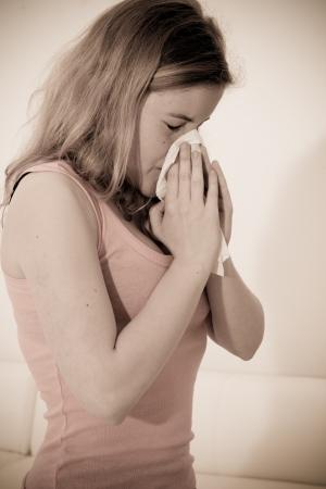 Sick woman using tissue Stock Photo - 14699353