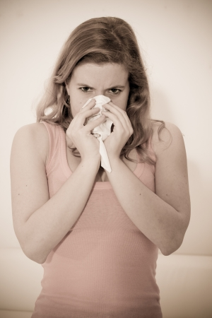 Sick woman using tissue Stock Photo - 14699358