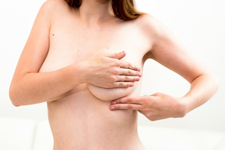 breast control - Woman holding her breast Stock Photo - 14699308