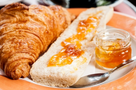 traditionally french: fresh croissant on table ,Delicious! Stock Photo
