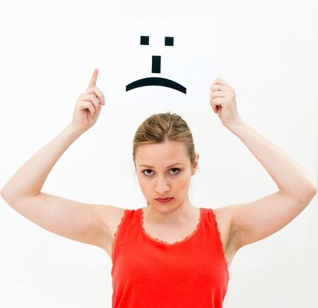 portrait woman with board sad emoticon face sign photo