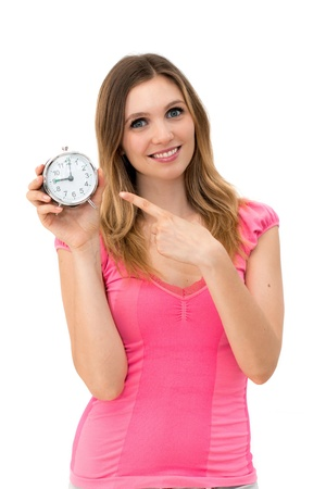 Wait,young beautiful woman holding a clock on a white background photo