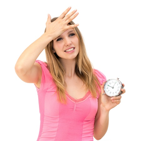 Too late,young beautiful woman holding a clock on a white background photo