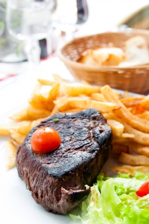 juicy steak beef meat with tomato and french fries Stock Photo - 15933325