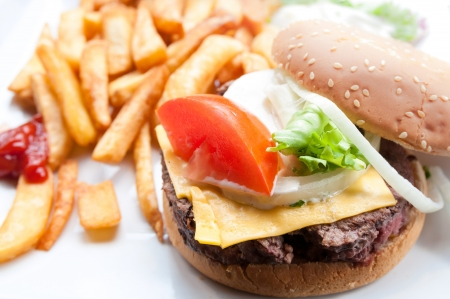 Cheese burger - American cheese burger with fresh salad photo