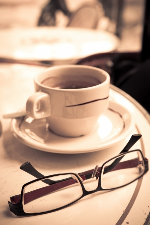 wonderful white cup of hot coffee on table photo