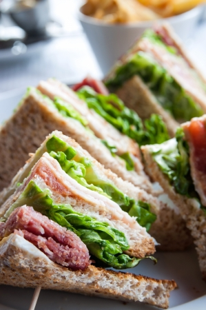 Sandwich with bacon - chicken, cheese and lettuce photo