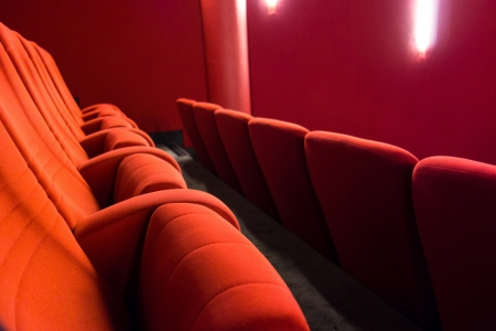 red cinema or theatre empty seats photo