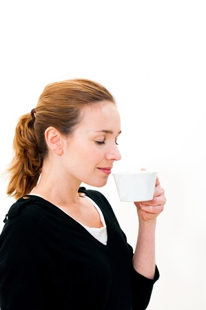 Portrait of a woman drinking coffee photo