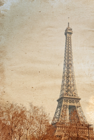 old-fashioned The Eiffel Tower (nickname La dame de fer, the iron lady),The tower has become the most prominent symbol of both Paris and France Stock Photo - 16256637