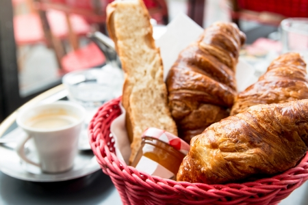 Breakfast with coffee and croissants in a basket on table Stock Photo - 16287623