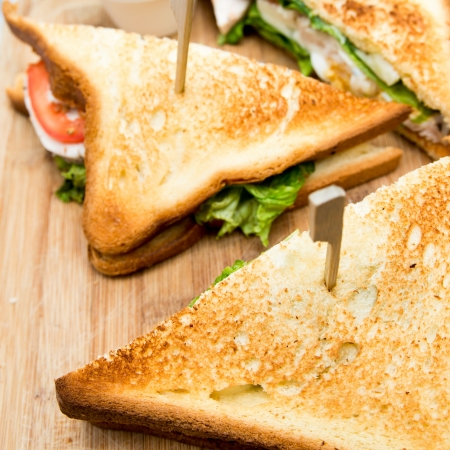 Sandwich with chicken, cheese and lettuce photo