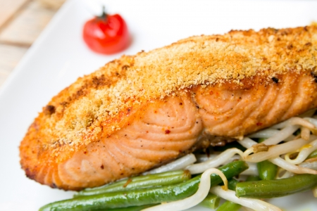 grilled salmon and tomato - french cuisine dish with tomato and salmon photo