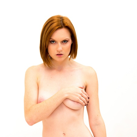 Sexy beautiful woman covering her nude breast, isolated on white background Stock Photo - 16853007
