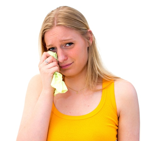 Sad woman with tissues on white background photo